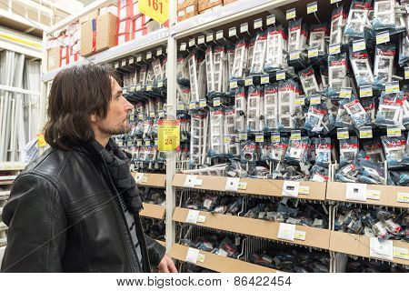 MOSCOW, RUSSIA - MARCH 03, 2015. man makes purchase of Leroy Merlin Store. Leroy Merlin is a French