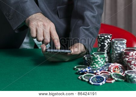 Man Holds Smartphone, Do Bet At Online Casino