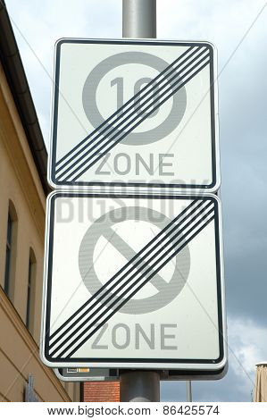 Speed Limit And No Parking Zone End Signs