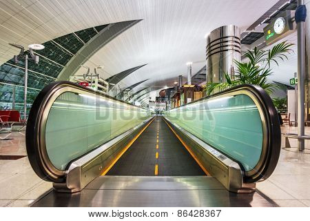 DUBAI, UNITED ARAB EMIRATES - NOVEMBER 7, 2009: Futuristic interior of international airport of Dubai. Dubai airport has a maximum capacity of 60 million passengers, 2.1 million tons of cargo per year