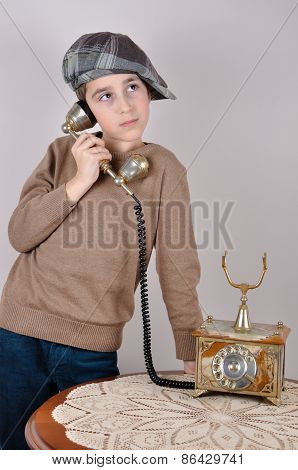 Young boy on the retro telephone