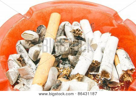 Many Butts In Glass Ashtray