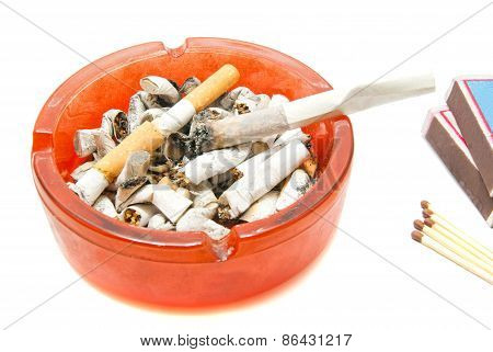 Butts, Matches And Cigarette On White