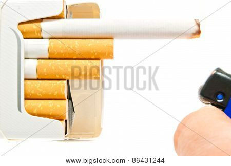 Hand With Blue Lighter And Pack Of Cigarettes