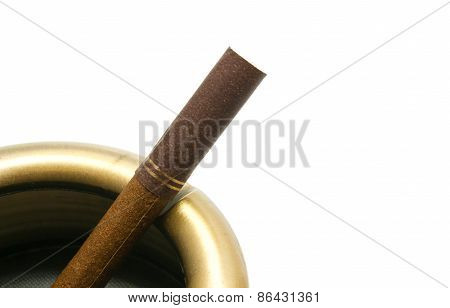 Cigarette With Filter In Metal Ashtray