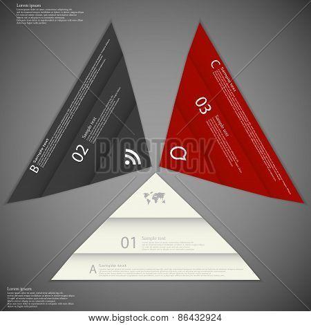 Three Folded Paper Pieces On Dark
