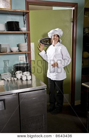 Female Chef In Restaurant