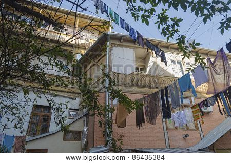 Inner courtyard of an apartment house with hanging laundry