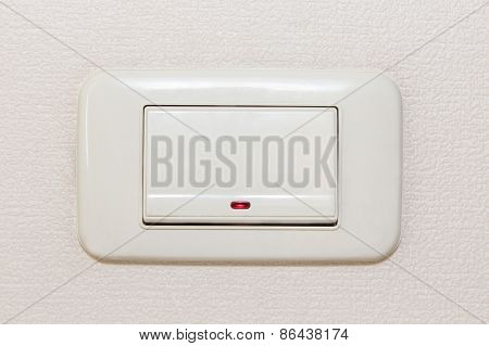 Light Switch On Beige Background.