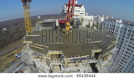 MOSCOW, RUSSIA - MAR 25, 2014: Builders work at construction site of Bogorodskoe at sunny spring day. Aerial view