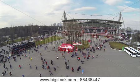 MOSCOW, RUSSIA - MAR 30, 2014: Lot of people walk away from Locomotive sports stadium after soccer match at spring day. Aerial view