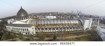 MOSCOW, RUSSIA - MAR 23, 2014: People walk near pavilions on territory of VDNH exhibition center at spring day. Aerial view