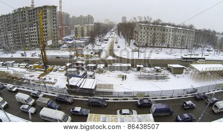 MOSCOW, RUSSIA - MAR 19, 2014: City traffic near building site of interchange on Shelkovskoe highway at winter day. Aerial view