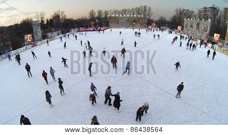 MOSCOW, RUSSIA - MAR 01, 2014: Skating rink with many people at winter evening. Aerial view