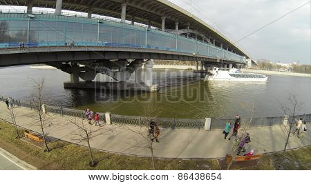 MOSCOW, RUSSIA - FEB 26, 2014: Aerial view of the walking people on embankment.