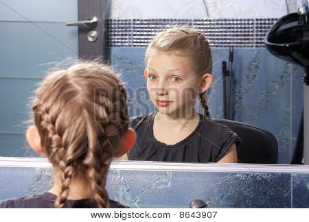 Girl Looking At Her Reflection