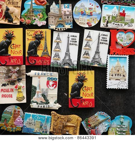 PARIS, FRANCE, MARCH 03 2015:  Magnets of eiffel tower, chat noir on a wall,  Great souvenirs of Paris, France.