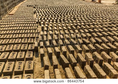 BHAKTAPUR, NEPAL - CIRCA DEC, 2013: On-site local Brick Factory. A survey found 74 kilns in the Bhaktapur district of KTM. In Kathmandu, respiratory problems occur at 12 times the national average.