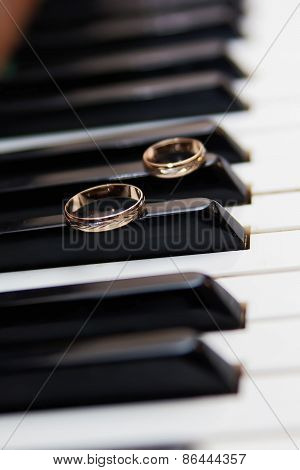 Wedding Rings On The Keys Of The Vintage Piano