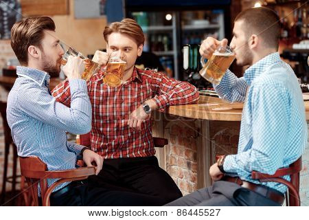 Friends have a beer at the pub