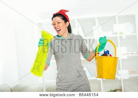 Funny woman mopping floor and singing