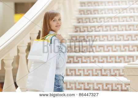 Girl goes shopping in the mall
