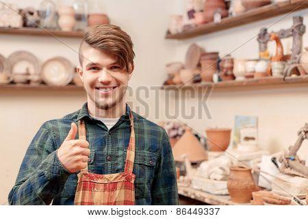 Man shows his thumb up