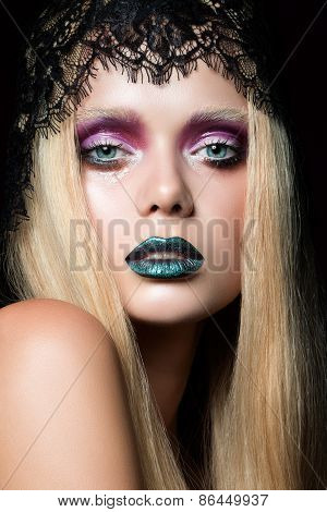 Fashion portrait of young woman with blue lips