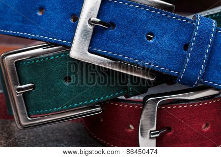 Close-up View Of Three Suede Belts