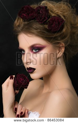 Close-up Portrait Of Young Woman With Dark Violet Party Make-up