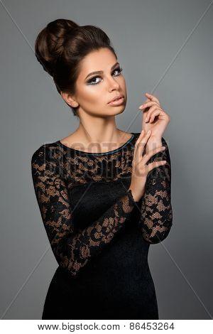 Portrait Of Young Beautiful Woman Wearing Black Dress