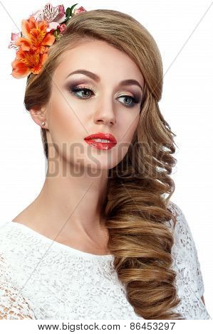 Portrait Of Beautiful Woman With Flowers In Her Hair