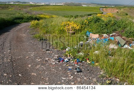 Beautiful Spring Field With  Garbage