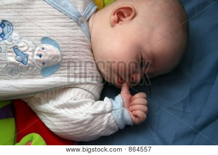 baby with thumb in the mouth