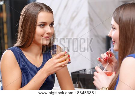 Women gossip in the bar