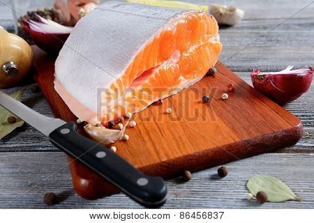 Raw Salmon Steak On A Cutting Board. Cooking Concept