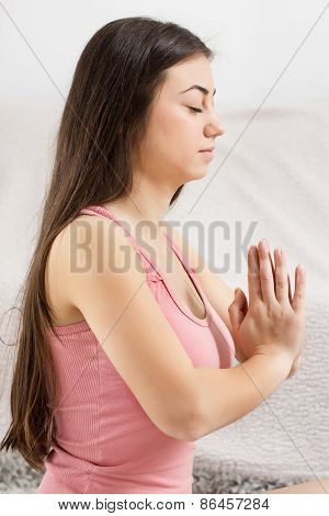 Young Woman Doing Yoga Meditating Relaxing Exercise