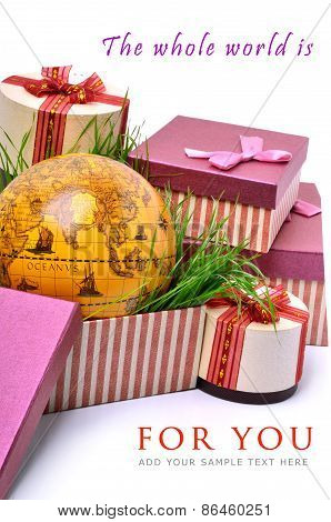 Beautiful Present Boxes, Green Grass And A Globe