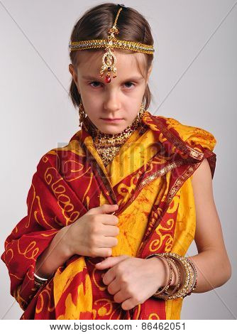 Gloomy Little Girl In Traditional Indian Clothing And Jeweleries
