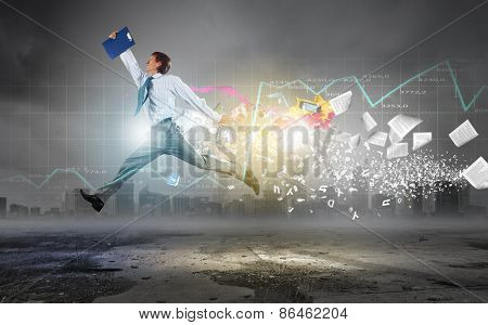 Businessman with briefcase jumping against digital background