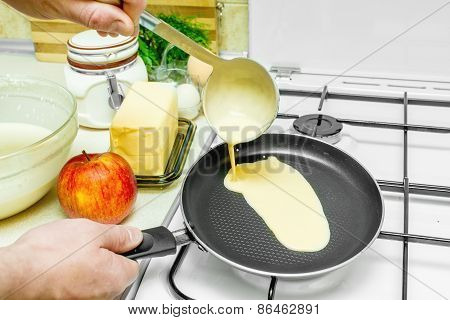 Cooking Pancakes In The Kitchen