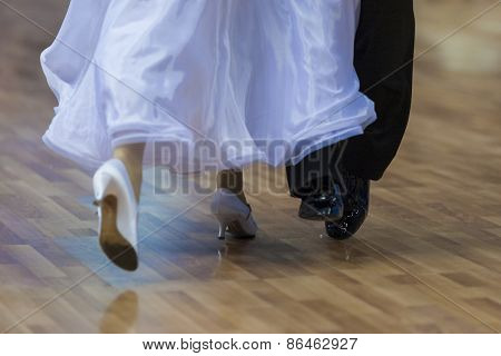 Closeup Of Legs Of The Professional Dance Couple Performing European Standard Program.