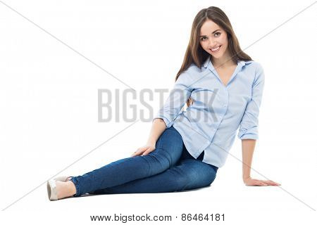 Young woman sitting on white background