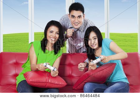 Happy Group Of Friends Play Video Games