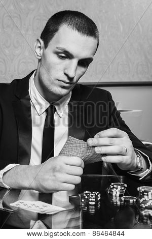 Poker player in the casino with glass