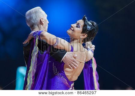 Minsk, Belarus-february 14, 2015: Senior Dance Couple Of Evgeniy Zhukov And Irina Zhukova Performs A