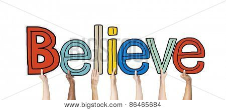 Group of Hands Holding Letter Believe