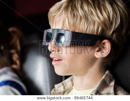 Closeup of boy watching 3D movie in cinema theater