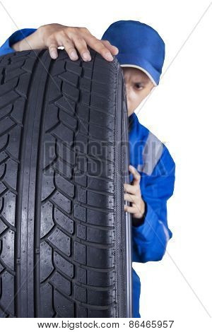 Mechanic Inspecting A Tire Texture