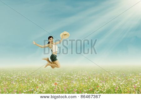 Woman Jumps On The Summer Park